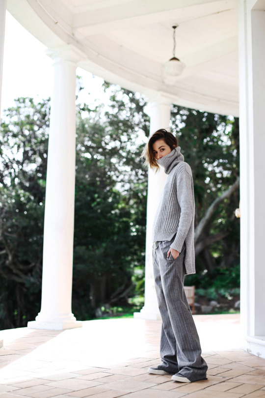 Carmen Hamilton in a tomboy style inspired outfit, oversized turtleneck sweater and pinstripe ash grey trousers Sweater: Country Road