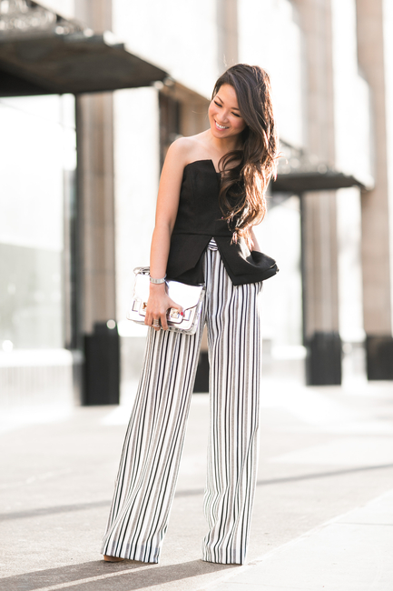 Wendy Nguyen in a pair of black and white vertically striped trousers from Asos