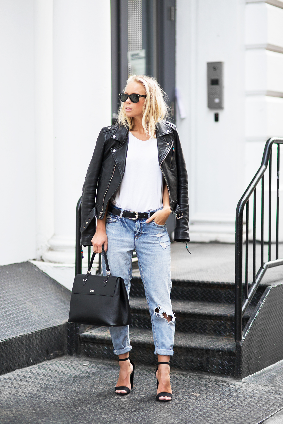 Street Style, Fashion 2015: Victoria Tornegren is wearing a leather BLK DNM biker jacket with a pair of denim Gina Tricot jeans, black NLY heels and a Prada handbag