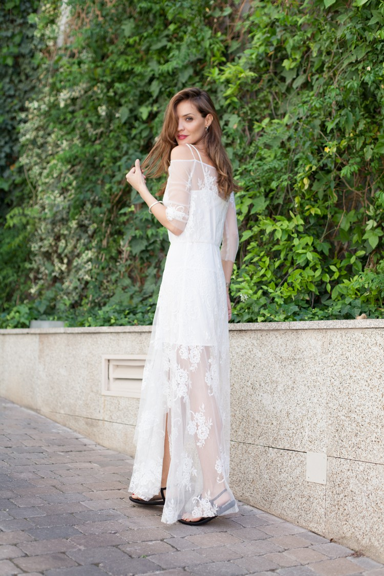 White Bohemian Lace Dress: Silvia Garcia is wearing a lace white Maje dress with a sheer lining