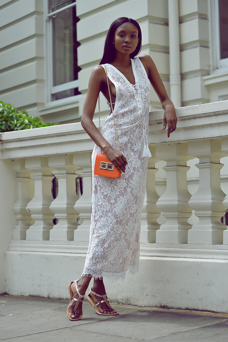 Natasha Ndlovu in a white lace maxi dress from Golden Rose