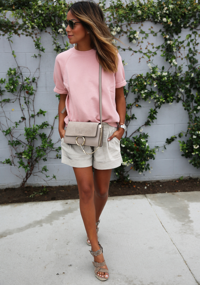e8b28d394db Solid colours are always a great summer look – especially when they re this  pink tee combined with beige shorts! Via Julie Sarinana