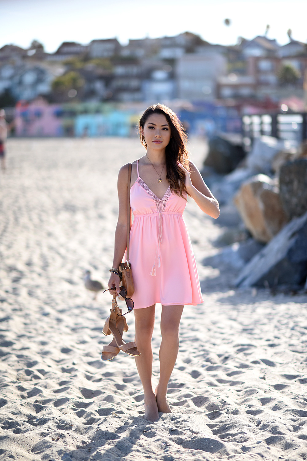 Jessica R. looks adorable in this super cute blush pink beach dress, with tassel detailing and an embroidered plunge neck. With or without heels this look is perfect for beach chic! Dress/Heels: Charlotte Russe.