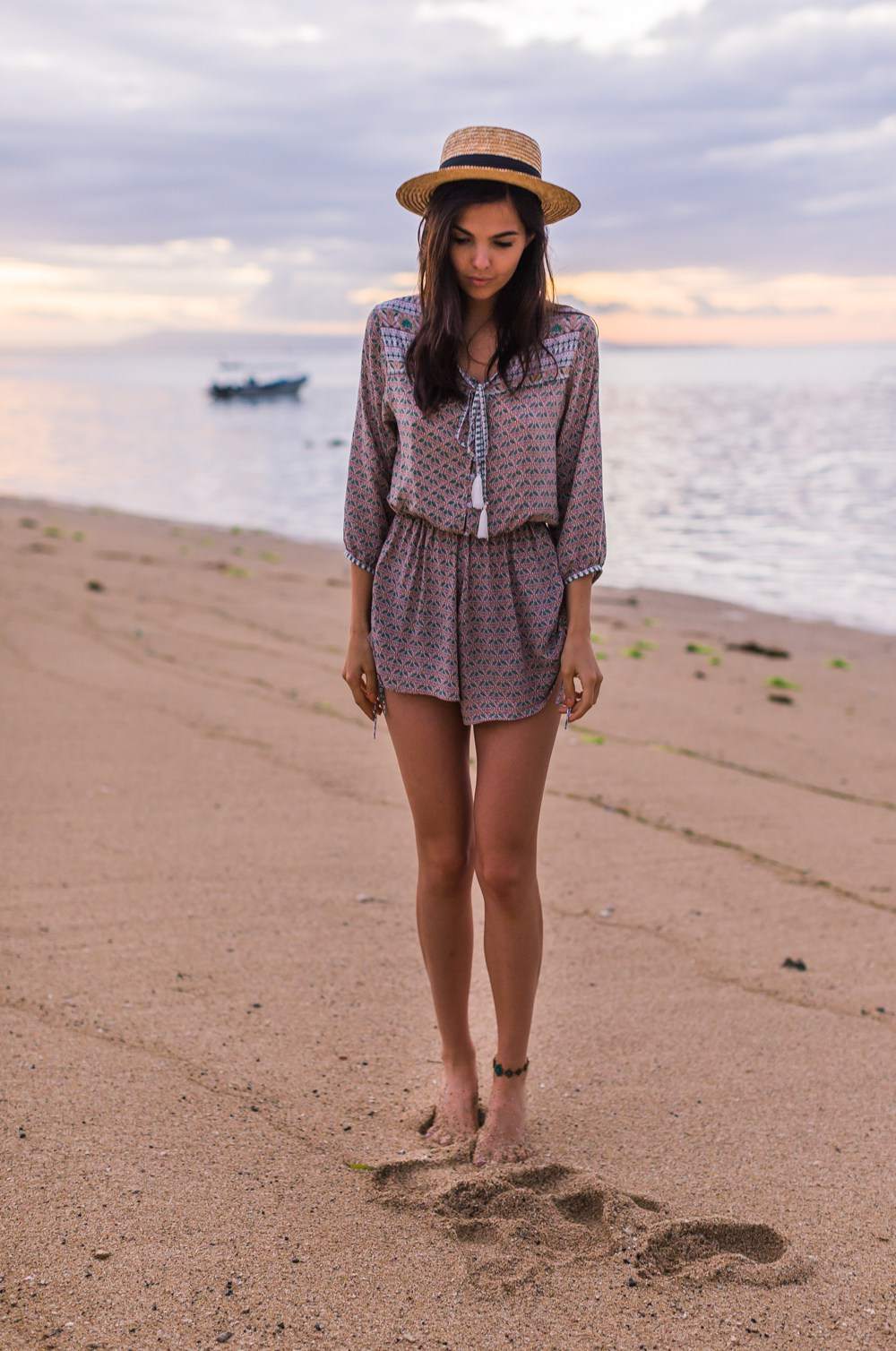 For a cute beach outfit idea, try wearing a loose and light patterned playsuit with a retro style straw hat like Doina Ciobanu. Not only is this look effortlessly summery, it is also a great way to cover up for an evening at the beach after swimming! Outfit: Faithfull The Brand.
