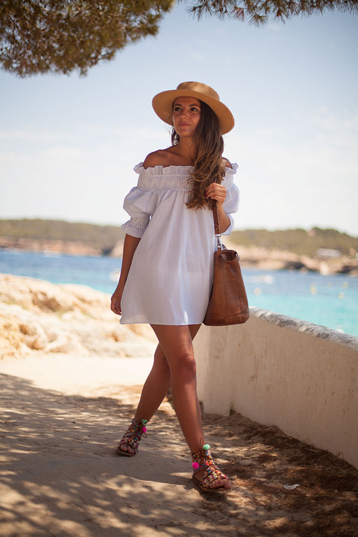 Off to the beach. The perfect outfit, striped off the shoulder dress, hat and sandals. Via Alexandra Pereira Dress: Chicwish, Sandals: Fetiche Suances, Bag: Malababa