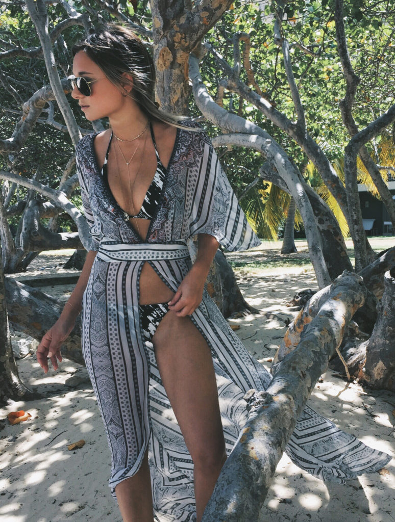 Is this the perfect beach outfit? Love the black and white bikini and cover up. Via Danielle Bernstein  Bikini: Onia, Cover Up: Camilla