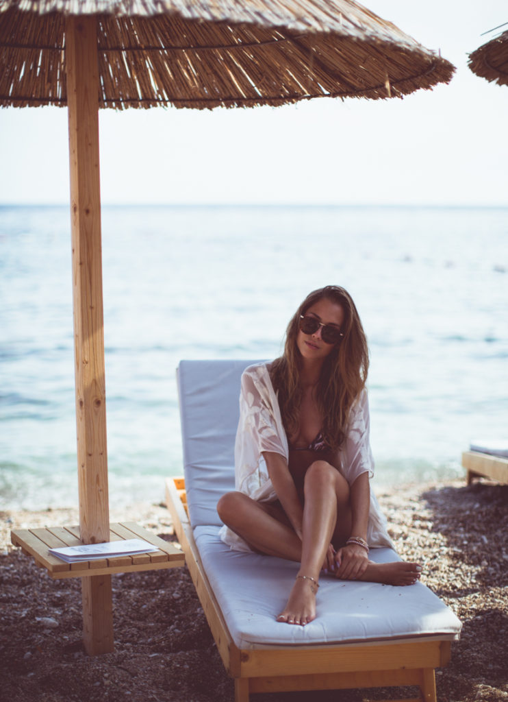 Whatever beachwear you are wearing you can't really go wrong with a see-through white cover-up. Via Kenza Zouiten