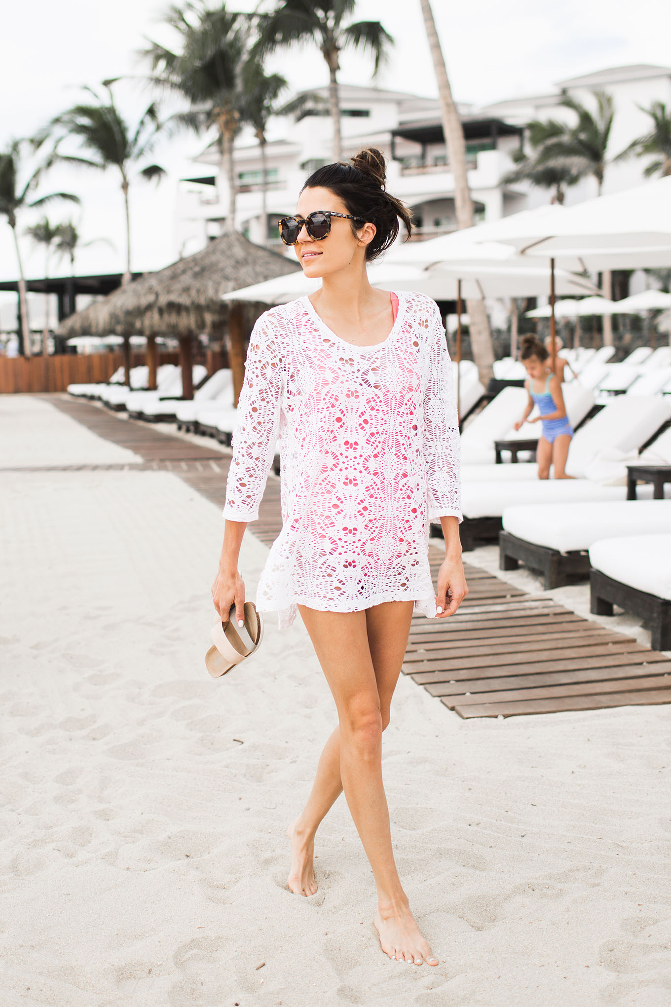 White lace is a winning choice to wear over swimwear at the beach! Christine Andrew wears this top as a dress, creating a cute and easy summer style! Top: Old Navy.