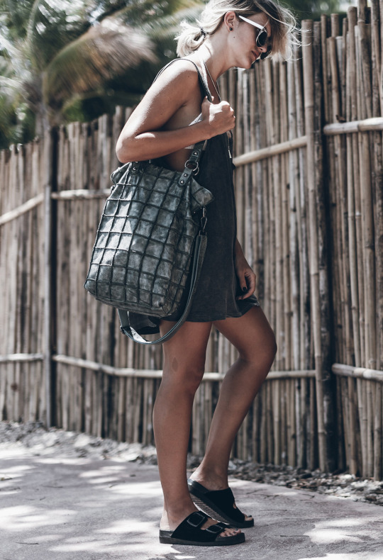 If you're searching for the ultimate beach style, look no further than Jacqueline Mikuta's cute and casual style. Pairing a grey tank top with Birkenstocks and a beach bag, Jacqueline has nailed the beach look! Bag: Freds Bruder.