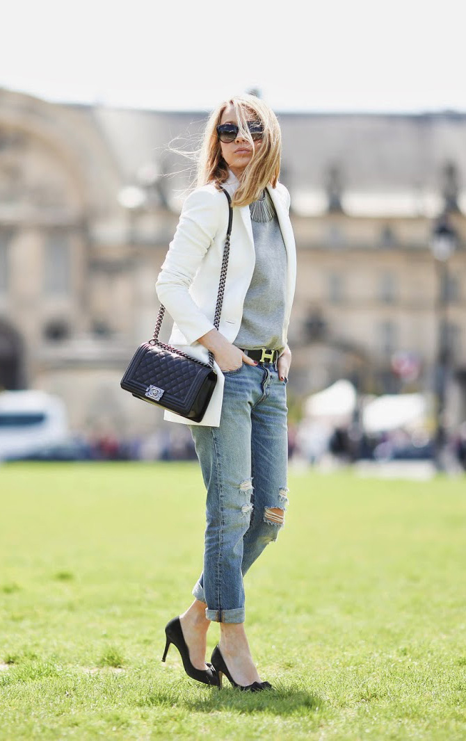 Coming up to summer, throw on a pair of boyfriend jeans and a white blazer, and really, you are ready for anything. Via Caroline Louis Sweatshirt: Atelier Duvivier, Jeans: Levi's, Blazer: Pearl and Rubies, Shoes: Isabel Marant