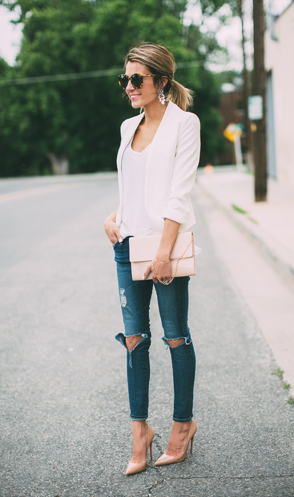 Pair a low cut neck line top with a white blazer, ripped jeans and nude shoes and bag. The neutral colour scheme and the various pieces makes for a very balanced look. Via Christine Andrew   Blazer: Topshop, Jeans: Alexa Chung, Tank Top: Leith, Shoes: Christian Louboutin