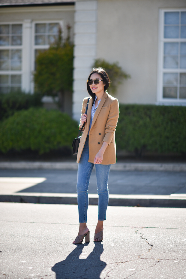 You can almost never go wrong when wearing camel. By pairing this gorgeous blazer with denim jeans and a pair of wedges, Anh has created a smart casual style which is perfect for everyday wear. Throw on a pair of shades to really bring this fabulous look together! Blazer: Banana Republic, Blouse: Everlane, Jeans: FRAME Denim, Bag: Celine, Heels: Gucci.