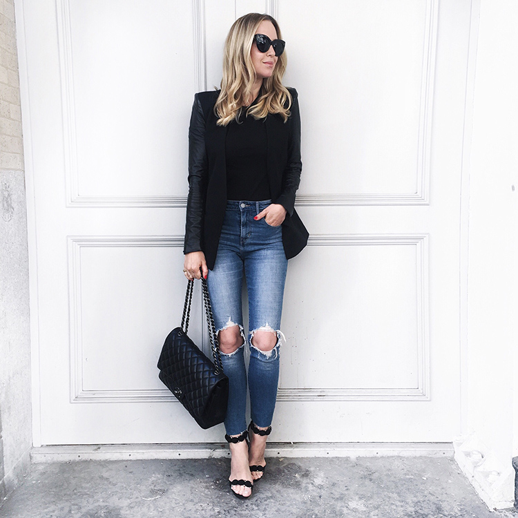 Nothing says smart casual like a blazer and jeans outfit. We love the contrast of the distressed denim and the sleek black blazer which Helena Glazer has created.   Blazer: Helmut Lang, Denim: Levis, Tee: Vince. Shoes: Alaia, Bag: Chanel Maxi.