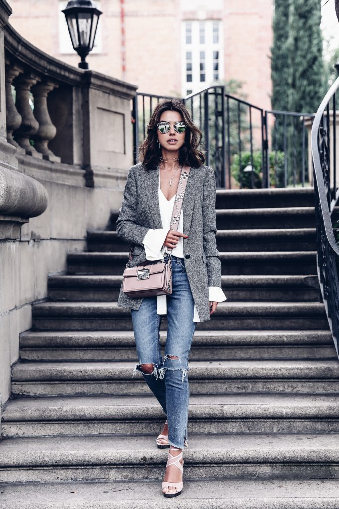 Annabelle Fleur is rocking this gorgeous androgynous style, consisting of a bell sleeved white tee, distressed denim jeans and a smart grey blazer. Wear this style when you want that perfect hybrid of smart and casual! Brands not specified.