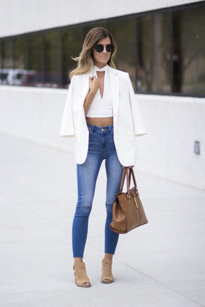 It can be refreshing to reinvent classic looks, so instead of a leather jacket or bomber, why not opt for a blazer and jeans combination this season? Brenna has created the perfect blend of smart and casual with this outfit – we love the playfulness of the ripped jeans and cropped top.   Blazer/Top/Jeans: Express.
