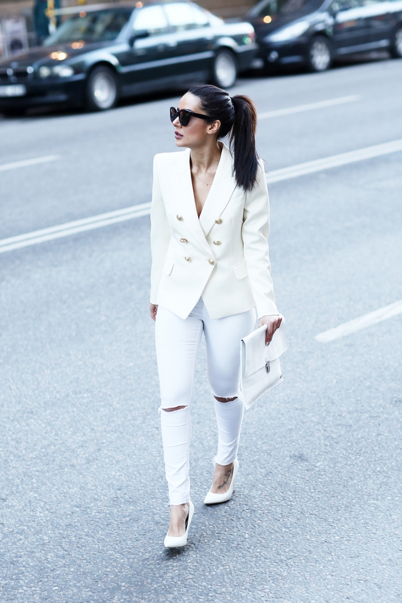 Sharareh Sophia Hosseini demonstrates exactly how to pull off the all-white look, pairing a gorgeous double breasted blazer with distressed white jeans and a pair of white stilettos. Blazer: H&M, Jeans: Bikbok, Heels: Have 2 Have, Sunnies: Celiné, Clutch: Saddler.