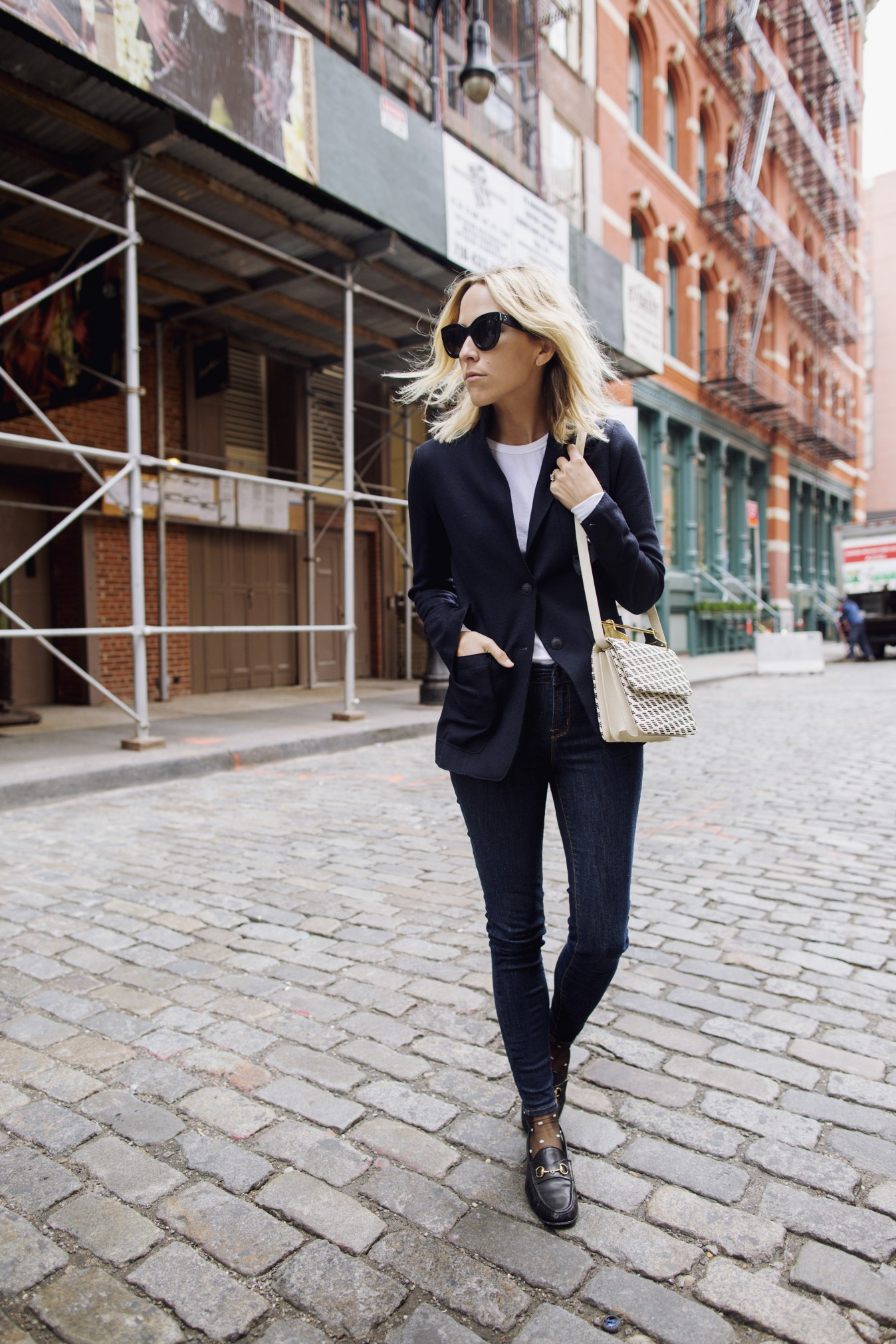 Jacey Duprie shows us how a blazer will make a fabulous alternative to a leather jacket or bomber when worn with simple denim jeans! Finish this look off with a cross body bag and loafers to steal Jacey's awesome style. Blazer: Rag & Bone, Loafers: Gucci Horsebit.