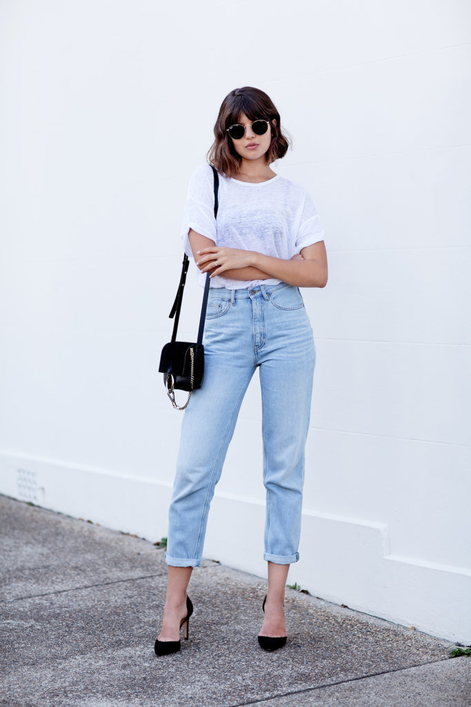 Boyfriend jeans are a must this season. Talisa Sutton has created a glamorous street style by pairing rolled up boyfriend jeans with black stilettos and a pair of retro shades; this is a look perfect for night or day!  Jeans: MiH, Tshirt: Isabel Marant, Shoes: IRO, Bag: Chloe.