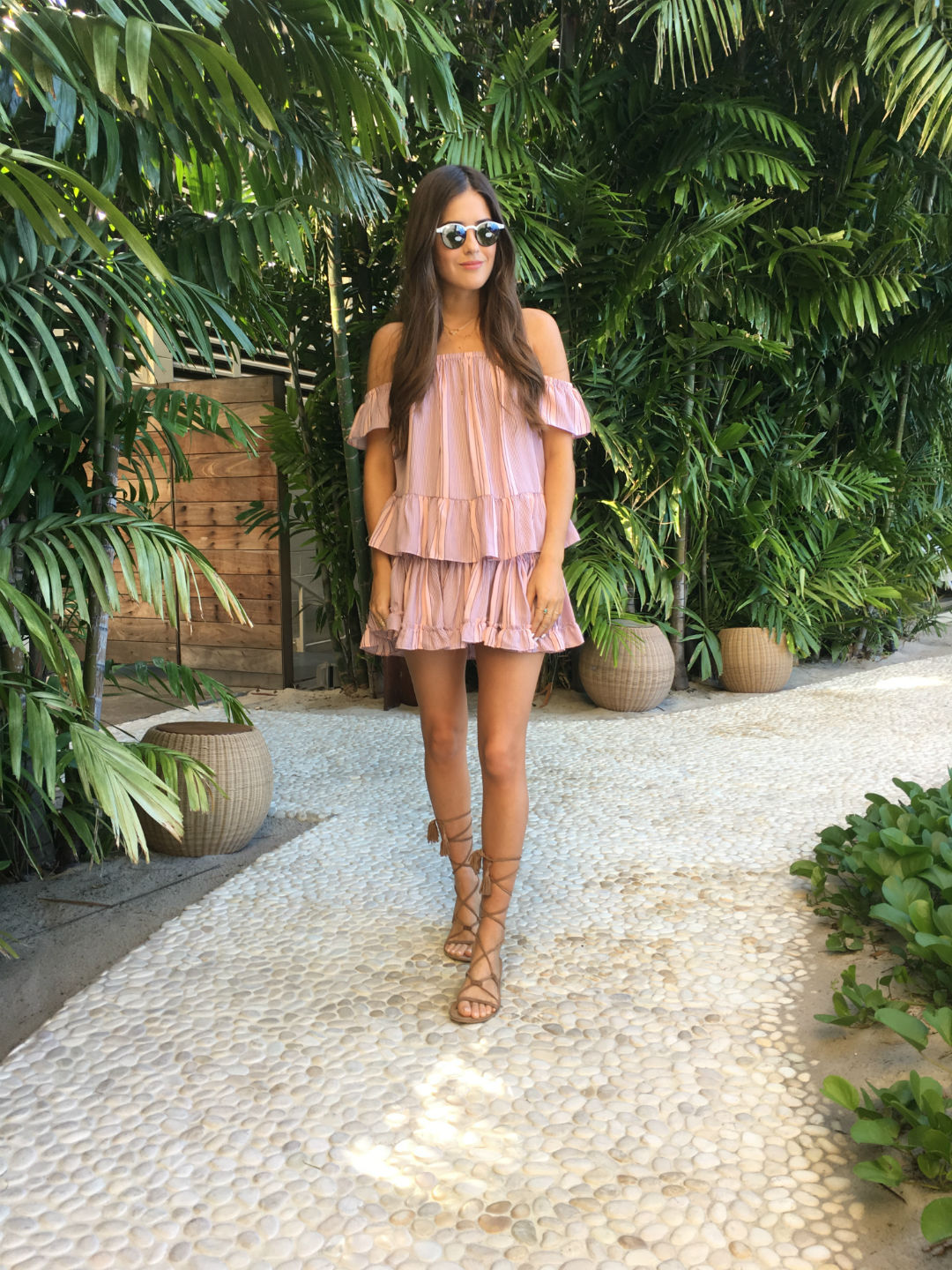 A pair of strappy gladiator sandals are a must have if you want to achieve a simple rustic style like this one, worn by Paola Alberdi. These authentic sandals look great paired with a blush pink ruffle dress, and together they create an awesome summer style! Blouse/Skirt: Misa Los Angeles, Sandals: ASOS.