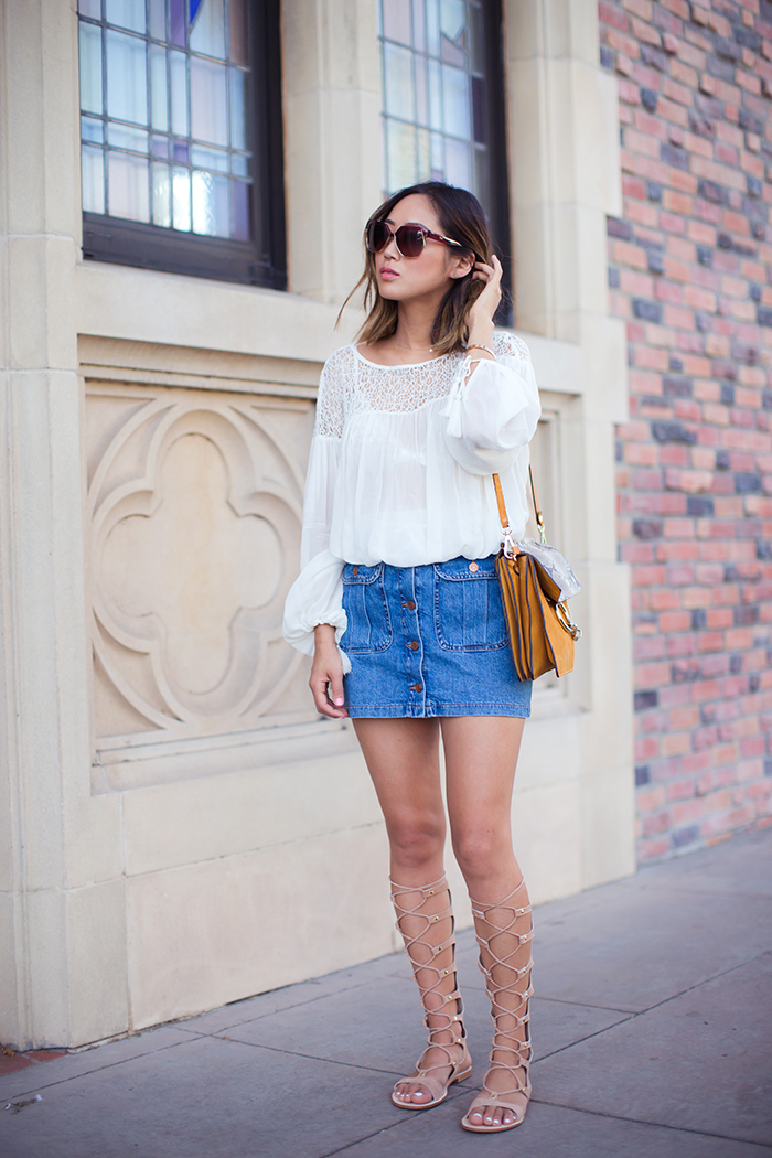 A flowy light white blouse, button front denim skirt and gladiator sandals. What could be more summery than that? Via Aimee Song Blouse/Skirt: Zara Sandals: Cornetti x Calypso St. Barths, Bag: Chloe Faye Handbag. Gladiator Sandals Outfits