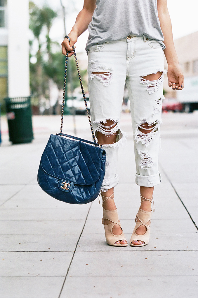 Like last year, the ripped boyfriend jeans are still on trend. Via Francesca Felix Jeans: One Teaspoon, Shoes: Aquazzura, Bag: Chanel