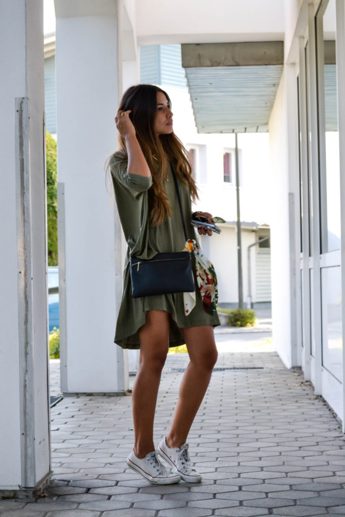 Consuelo Paloma is wearing a khaki T-shirt dress and white Converse  Dress: Asos