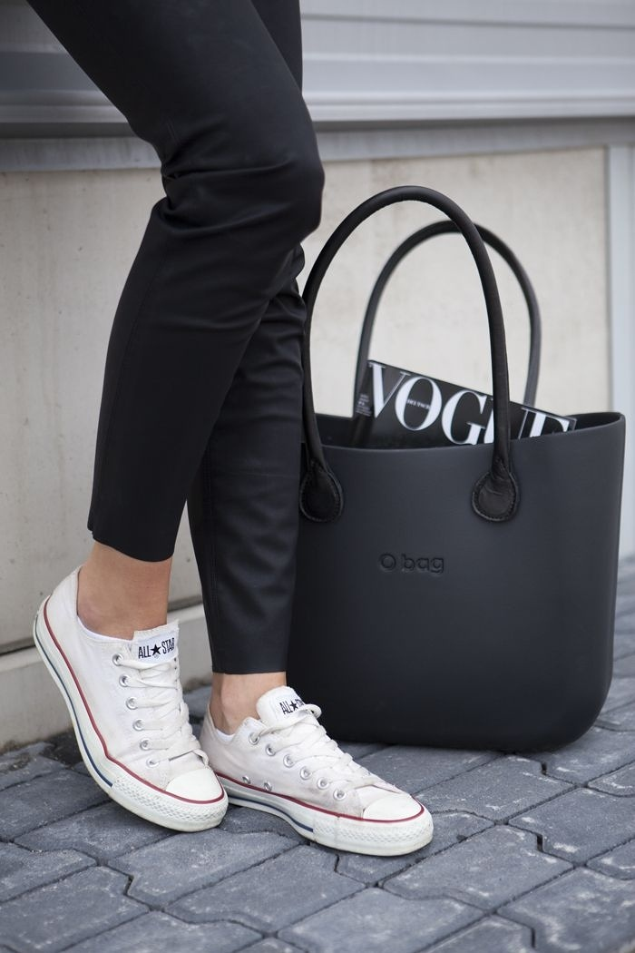 The white Converse will of course always work with an all-black outfit. Via Sarah Yates