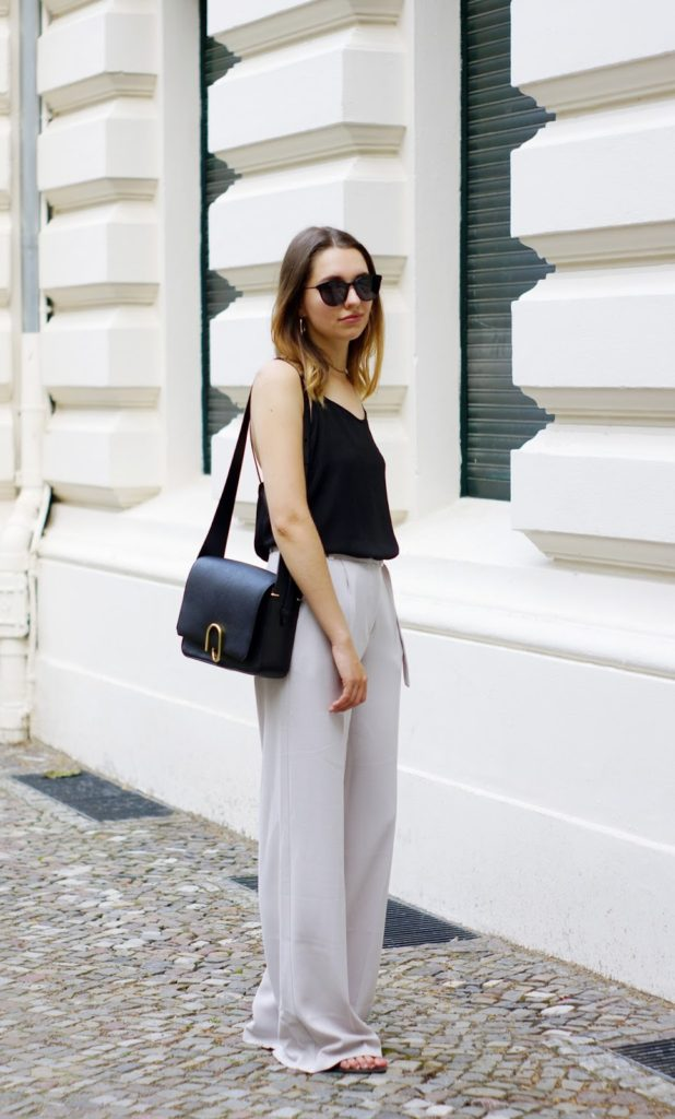 Why not try pairing palazzo pants with a stylish vest and chunky accessories to steal Diana DeMarino's elegant summer style. This look is ideal for those warm evenings, and can be dressed up with heels for a night out!   Top: Unknown, Trousers: Asos, Bag: 3.1 Phillip Lim Alix.