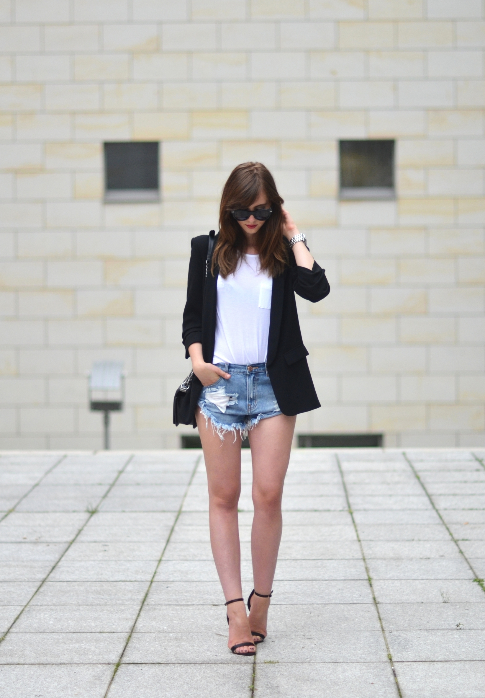 Wear your favourite white tee with a short black blazer, denim shorts and simple sandals. Via Barbora Ondrackova Shirt/Shorts: Topshop, Blazer: Zara, Shoes: Asos, Bag: Chanel. A Summer Outfit Idea