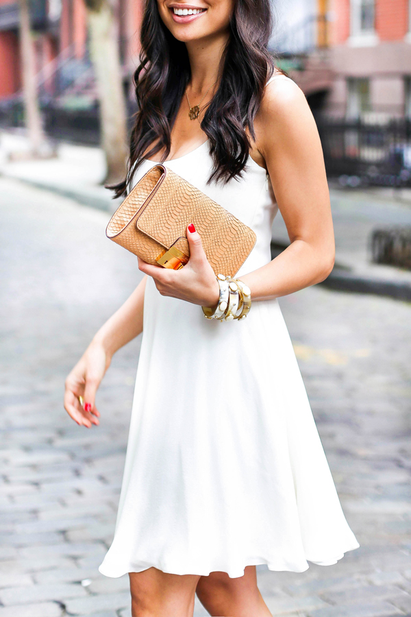 Probably the easiest of summer outfits to pull off. The little white dress. This particular one falls really well. Via: Kat Tanita  Dress: Ralph Lauren, Clutch: Michael Kors