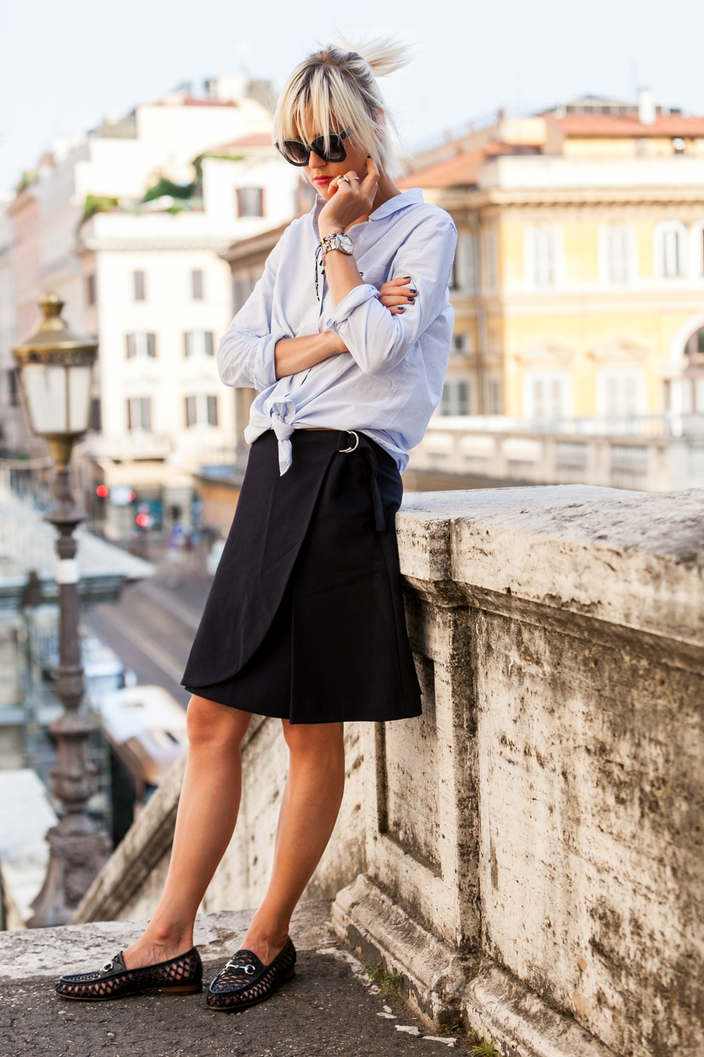 Pale blue boyfriend skirt, dark navy skirt and shoes to die for. Via Linda Tol Shirt: Ganni, Skirt: Filippa K, Sunglasses: Celine, Shoes: Gucci.