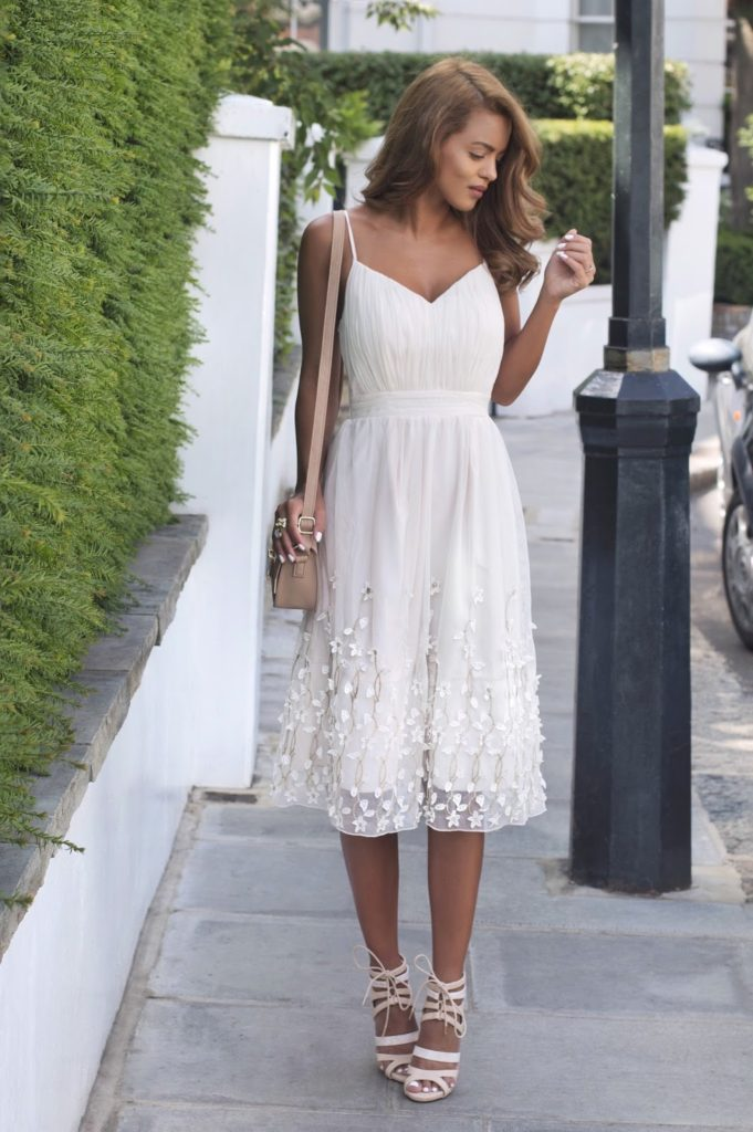 The sheer detail at the bottom of the dress is spot on and so are the sandals and cream bag. Via Nada Adelle.  Dress: Little Mistress By Look Magazine Collection, Ankle Lace Up Heels: Loud Look.
