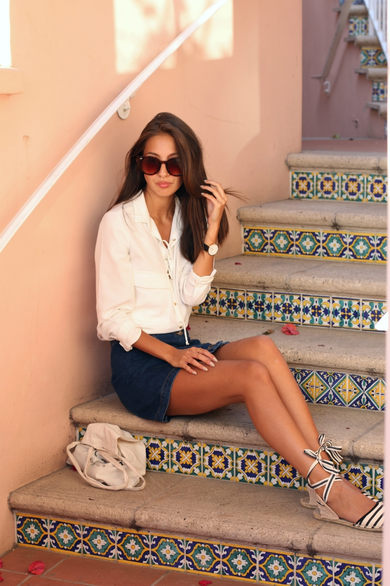 The lace up-front top and mini skirt is on point for this summer. Via Felicia Akerstrom Shoes: Soludos, Skirt/Top: Zara, Sunglasses: Plastictail