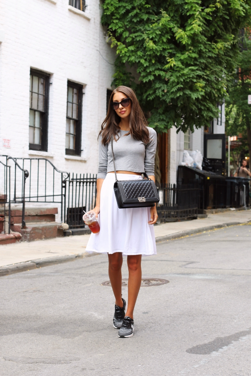 Cute Summer Outfit: Grey crop top and sneakers with a simple white skirt. So easy. Via Felicia Akerstrom Skirt: Zara, Top: Topshop, Sneakers: Nike, Bag/Sunglasses: Chanel