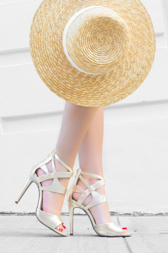 Detail: Summer shoes and a straw hat. Via Sarah Butler