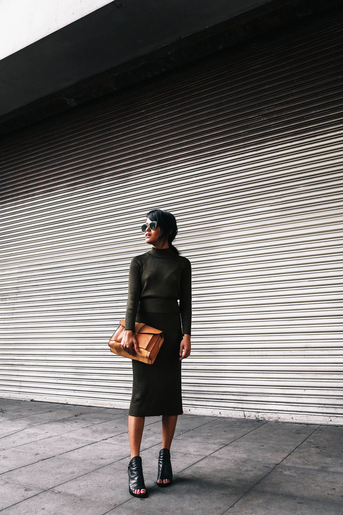 Olivia Lopez wears a gorgeous matching khaki skirt and sweater with a leather satchel and open toe sandals.  Turtleneck/Pencil Skirt: Bar III, Boots: Festa, Bag: Marni.