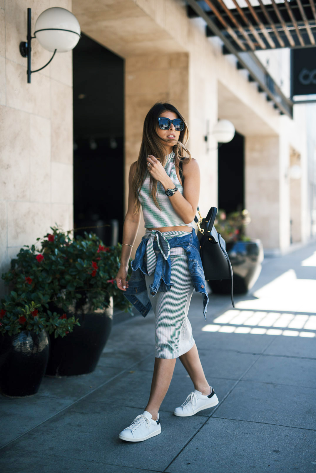 A crop top and midi skirt two piece is always a winner! Pam Hetlinger wears this super cute summer style with a pair of sleek white sneakers for a casual and street-ready look! Top/Skirt: Club Monaco, Sneakers: Isabel Marant.