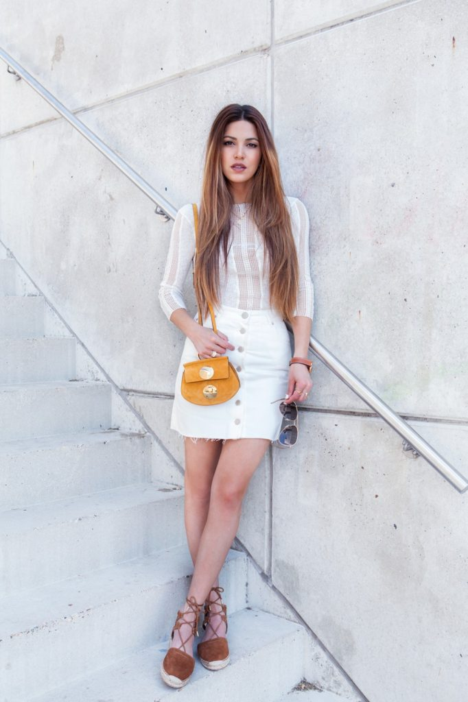 All white outfit with a cotton and lace top combined with a white button front denim skirt and suede espadrilles. Via Negin Mirsalehi  Top: Maje, Skirt: Asos, Espadrilles: Aquazzura, Bag: Chloé, Sunglasses: Saint Laurent. White Denim Skirt Outfit