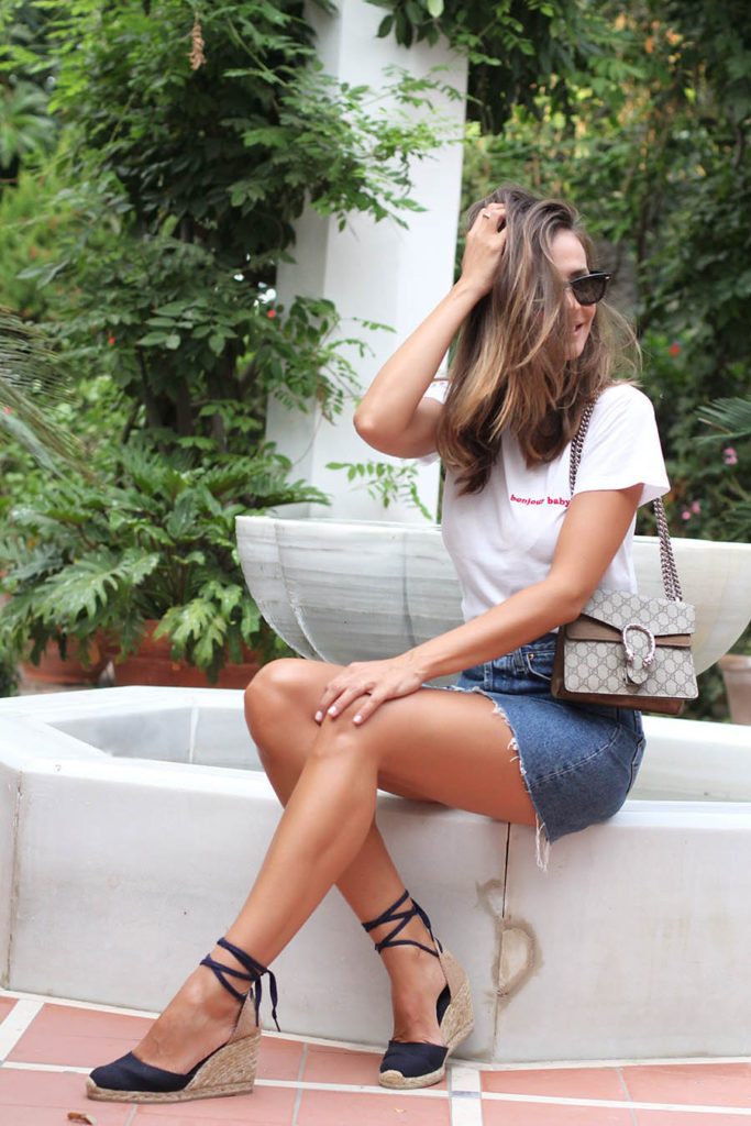 Silvia Garcia is killing this super cute denim skirt look, pairing a simplistic white tee with a frayed skirt and gorgeous navy platforms. A style such as this is perfect for summer, and can be worn with effortless glam at the beach or club!  Top: Brandy Melville, Skirt: Levi's, Shoes: Sarenza, Bag: Gucci.