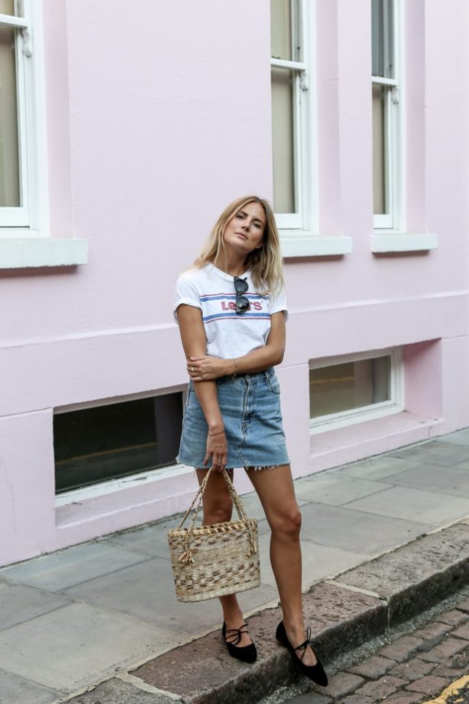 For a cute and casual summer style, why not copy Lucy Williams and pair a denim skirt with a simple graphic tee? This look is achievable and affordable, and suitable for any occasion!   Shoes: By Far, Skirt: Urban Outfitters, Tee: Levis, Bag: Vintage.