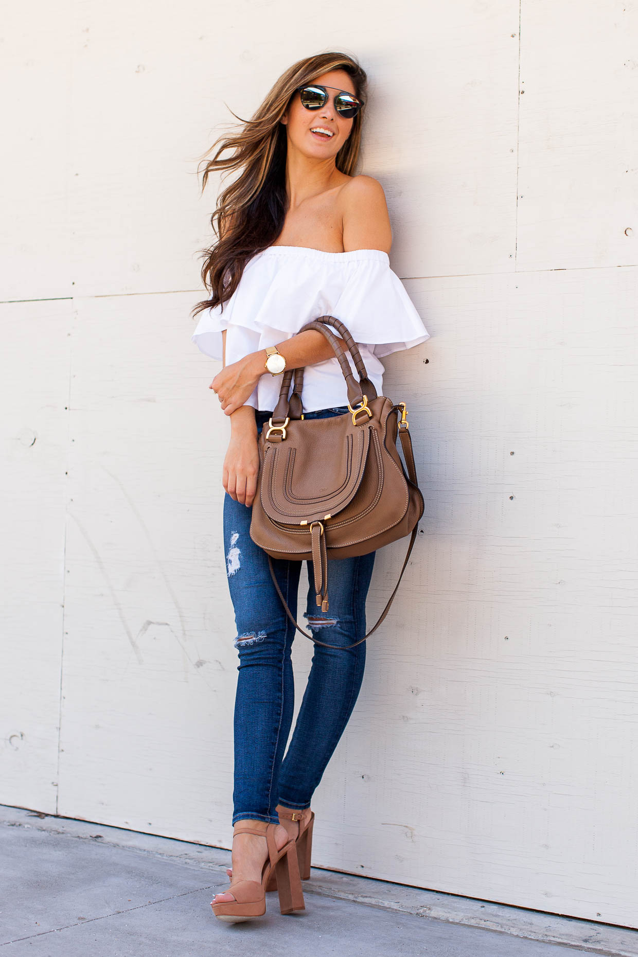 Jessi Afshin is looking ultra glam in this statement white off the shoulder top; worn with skinny jeans and platforms this is simply the perfect style for summer! Top: Topshop, Jeans: AG, Shoes: Steve Madden.