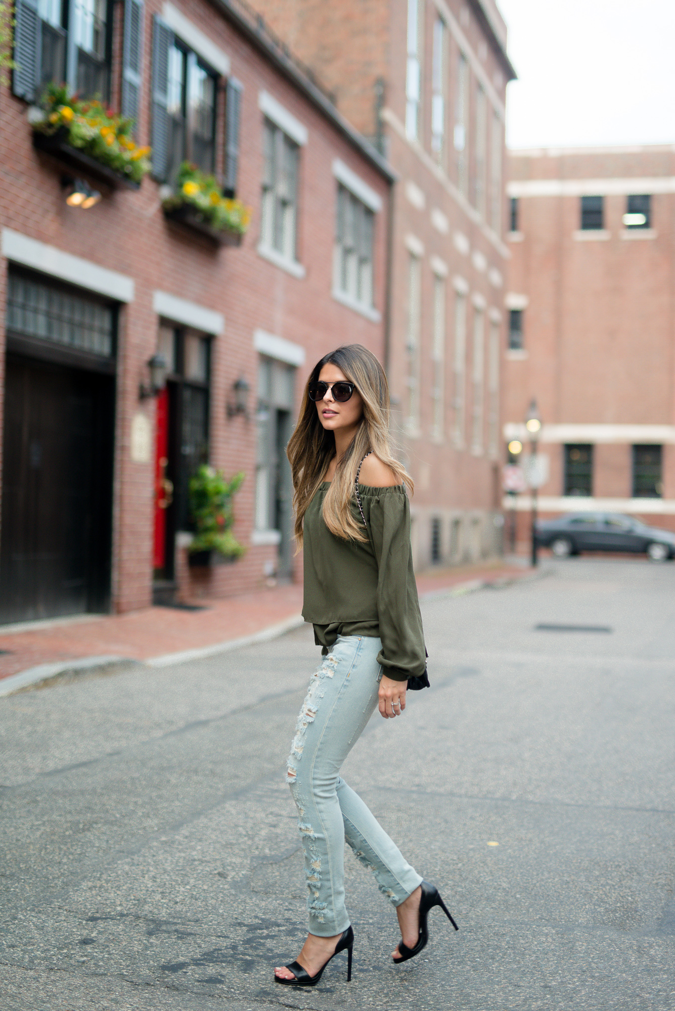 Ripped jeans and a khaki off the shoulder top. Pam Hetlinger shows us what this summer is all about. Top: Asos, Jeans: BlankNYC, Shoes: Saint Laurent, Sunglasses: Wonderland
