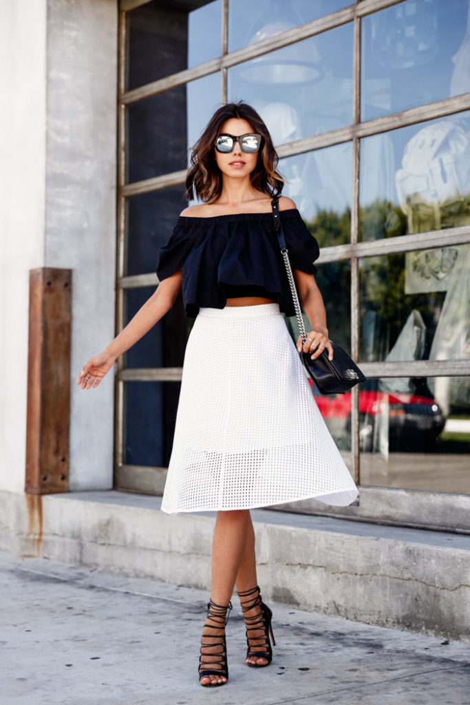 We love the white eyelet skirt and those shoes too, but really, it is all about that black off the shoulder top. Via Annabelle Fleur  Top: Free People, Skirt: Club Monaco, Shoes: Aquazurra, Bag: Chanel. Off The Shoulder Top Outfits