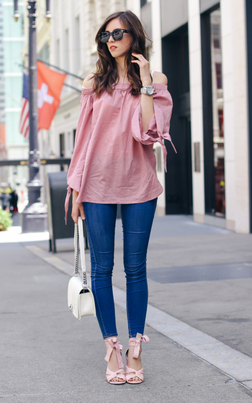 Barbora Ondrackova is looking super feminine in a gorgeous blush pink off the shoulder top, matched perfectly with a pair of ballet style ribbon-tie heels in the same shade. Try this look with denim skinny jeans to steal Barbora's beautiful spring style. Top: NA-KD, Jeans/Heels: Topshop, Bag: Chanel.