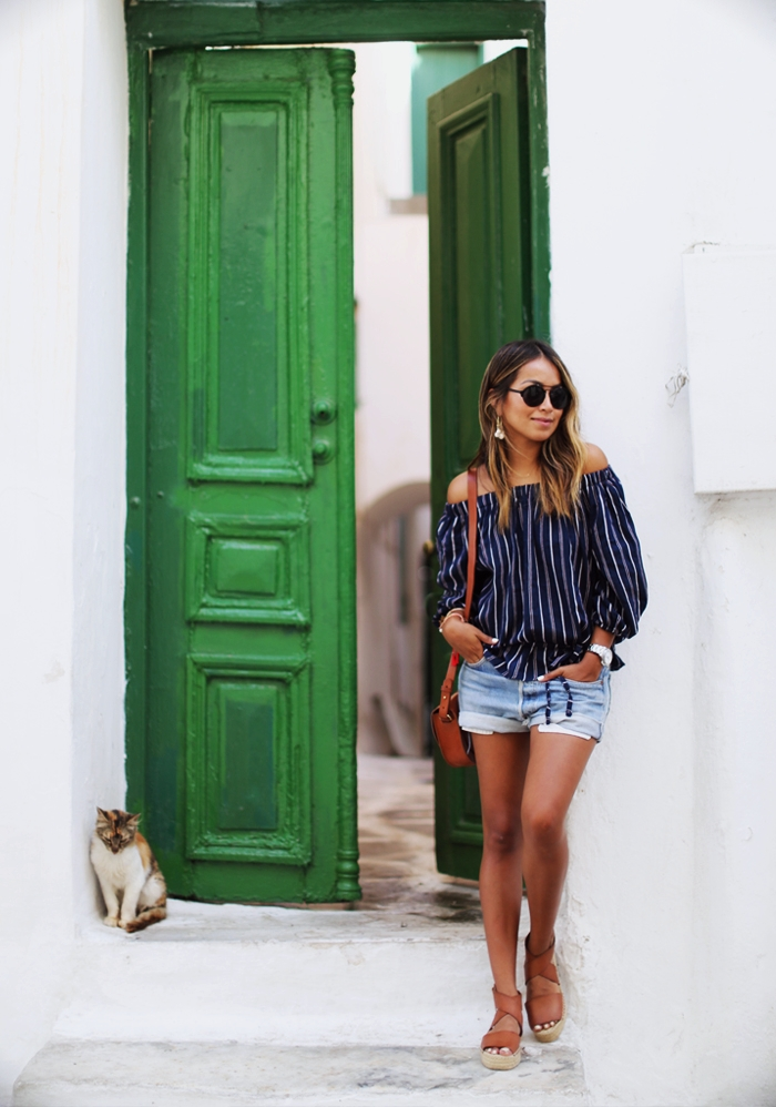 This striped off the shoulder top looks effortlessly cute paired with vintage denim shorts and casual sandals. Via Julie Sarinana.  Top: Storets, Shorts: Levi's Vintage, Sandals: Vince.