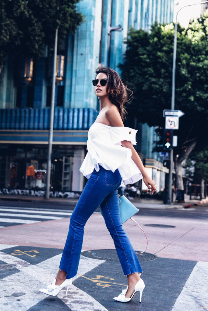 The off the shoulder top is a must-have this summer! Not only does revealing your shoulders scream confidence and sexiness, the flowing nature of the design means you will look as cool as you feel. We love this look, via Annabelle Fleur.   Top: Viva Aviva, Jeans: M.I.H, Bag: Louis Vuitton.
