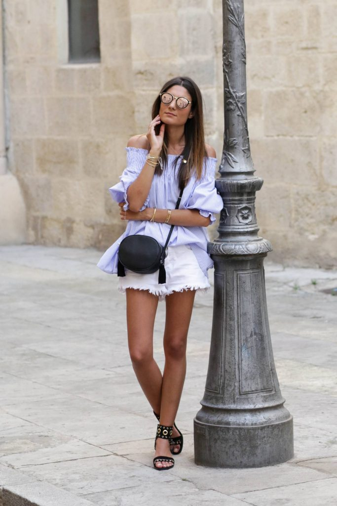 Federica L. is wearing a beautifully simple outfit here, consisting of an oversized off the shoulder blouse, frayed white denim shorts, and a pair of metallic decorated sandals. This style is perfect for any mid-winter vacation! Blouse: Believe E, Shorts: Boohoo.