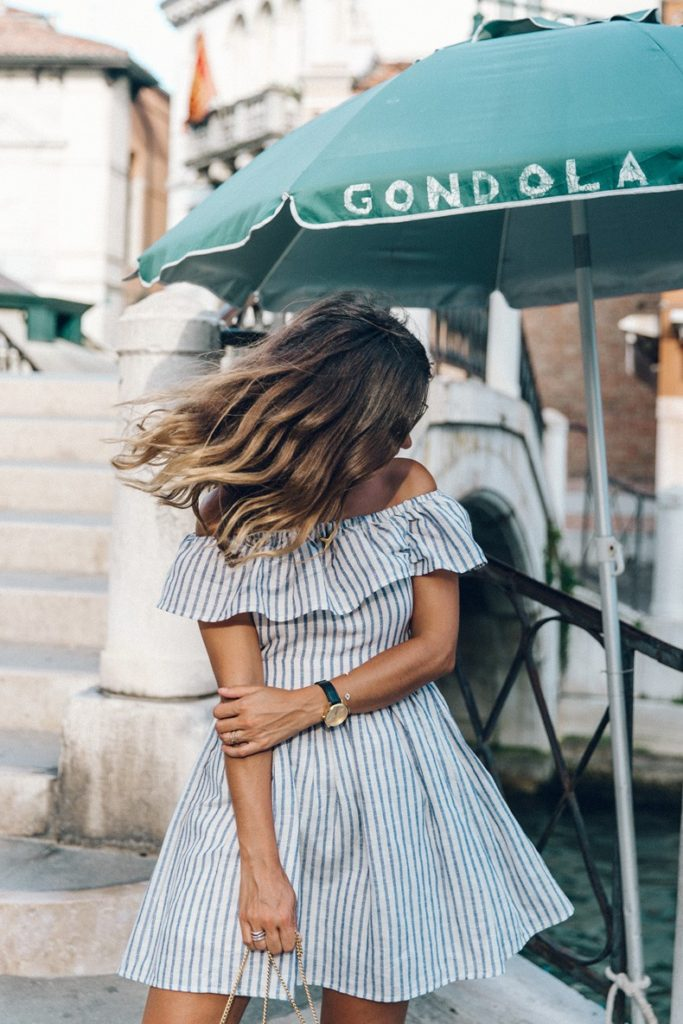 Both the vertical stripes and the off the shoulder is still going strong. Via Sara Escudero  Dress: The Jetset Diaries