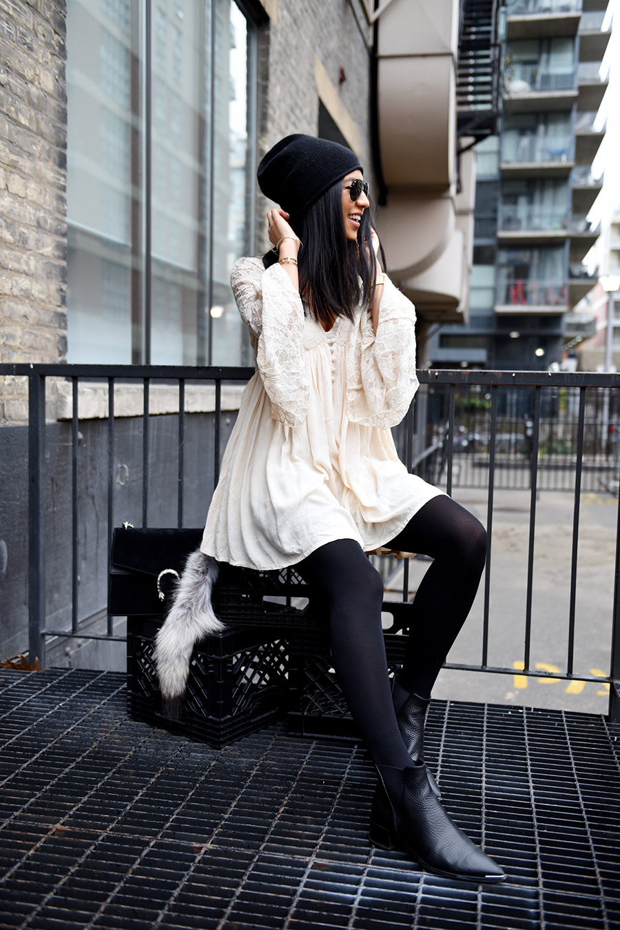 The bell sleeve and lace trends can go absolutely hand in hand, as seen here in this gorgeous cream lace dress with sleeve detailing. Kayla Seah wears this look with Chelsea boots and a cute black beanie. Dress: Free People, Boots: Acne, Bag: Gucci, Beanie: Halogen.