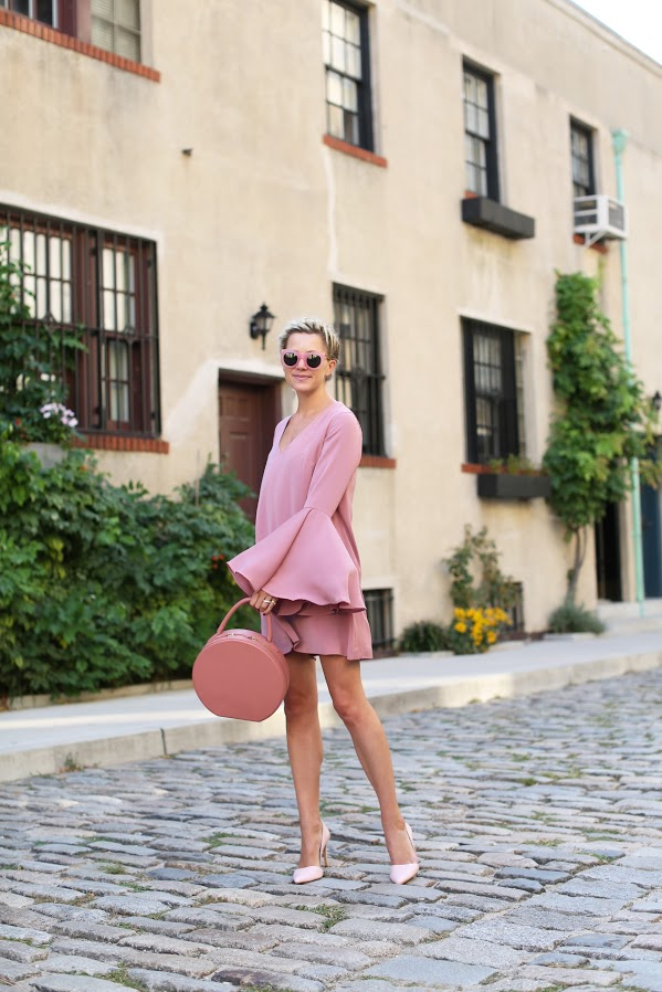 Bell sleeved dresses are the ultimate summer trend, and when paired with heels they will make for a super feminine seasonal look! Blair Eadie wears the trend in a gorgeous shade of blush pink, creating a pastel aesthetic we love!  Dress: Keepsake, Flats: Chanel, Heels: Old, Bag: Mansur Gavriel.